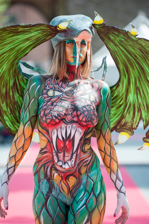 Florence, Italy - April 24, 2018: Colorful Fantasy character created with the body painting technique, at the ? ?? Exhibition of Handicraft 2018?? , in Florence. Stock Photo
