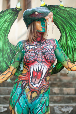 Florence, Italy - April 24, 2018: Colorful Fantasy character created with the body painting technique, at the ? ?? Exhibition of Handicraft 2018?? , in Florence. 版權商用圖片