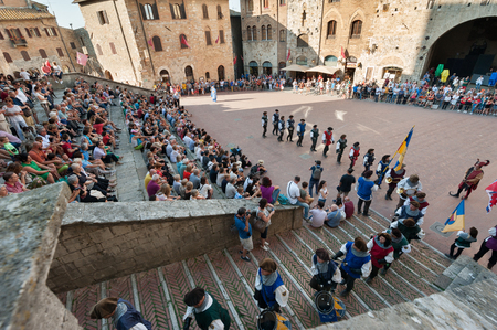 San Gimignano, Siena, Italy - 2018, June 17: Parade of extras in medieval suit, during the historical reenactment