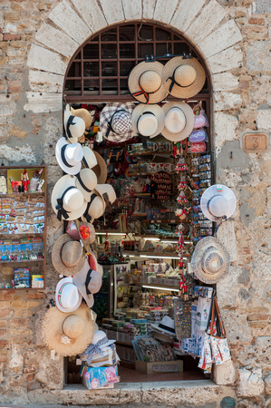 Many straw sun hats for sale in the Italian souvenir shop