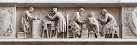 Master stonemasons, woodcarvers, and sculptors, represented in a bas-relief (1408) on the external facade of the Orsanmichele Church, Florence, Italy