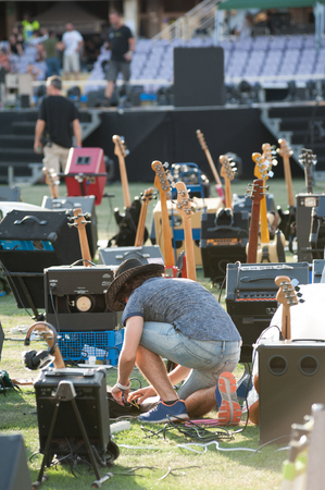 Guitarist checks the equipment before the rock festival at the stadium Redakční