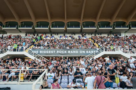 Florence, Italy - 2018, July 21: audience in the stadium bleachers during the ? ?? Rockin? ?? 1000 - That? ?? s Live?? , the biggest rock band in the world.