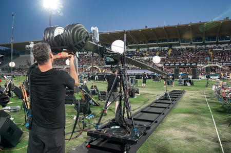 Florence, Italy - 2018, July 21: Camera operator set the crane during the ? ?? Rockin? ?? 1000 - That? ?? s Live?? , the biggest rock band in the world.