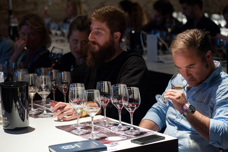 Tasting a glass of wine during a wine tasting event.