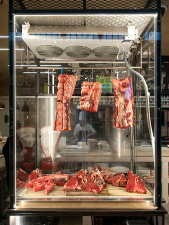 raw fiorentina steak in a display cabinet at the restaurant Stock Photo