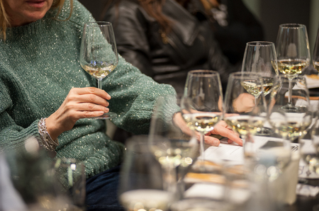 People tasting white wine during a masterclass. Stock Photo
