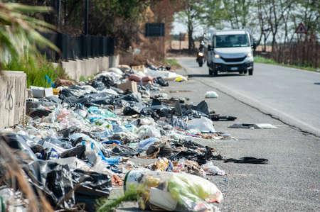 Garbage heap along a road, near Rome, Italy. Environmental degradation concept.