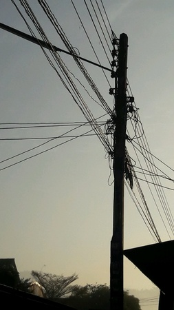 electric current: Column electricity evening In rural villages in Thailand. Stock Photo