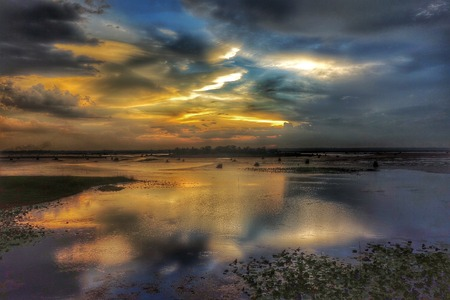 awesome wallpaper: Clouds sunset sky water reflection  Stock Photo