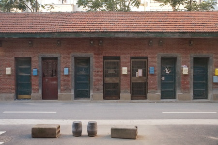 redbrick: On October 9, 2015, Zhengzhou, Henan,in a residential district, a lot of colorful newspaper boxes, milk cartons were installed on the wall. The red-brick wall seemed very beautiful topped with the colorful boxes. Editorial