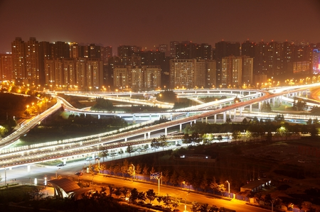 a nocturne: Night view with traffic trails on flyover Zhengzhou zhengdong CBD, Henan Province, China
