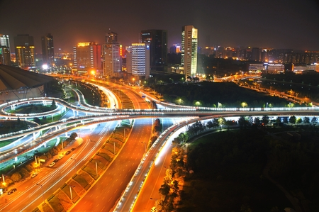a nocturne: Night view with traffic trails on flyover, Zhengzhou zhengdong CBD, Henan Province, China