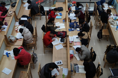 studious: Undergraduates studied hard in the library of Zhengzhou University on 18 November,2015, Zhengzhou City, central Chinas Henan province. They were making preparations foe the National Postgraduate Entrance Examination of 2016, which will be hold on 26 Dece