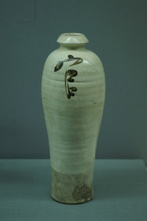 song dynasty: White Glazed Porcelain Vase with GuanOfficial Character. Song Dynasty 960-1279A. D. Museum of Kaifeng City, Henan Province. Editorial