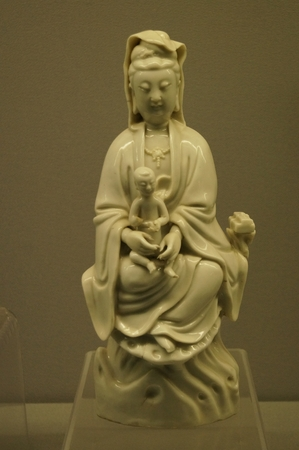 goddess of mercy: Figure of Goddess of Mercy with a Baby in Arms of Dehua Kiln. Ming Dynasty 1368-1644A. D. Museum of Kaifeng City, Henan Province. Editorial