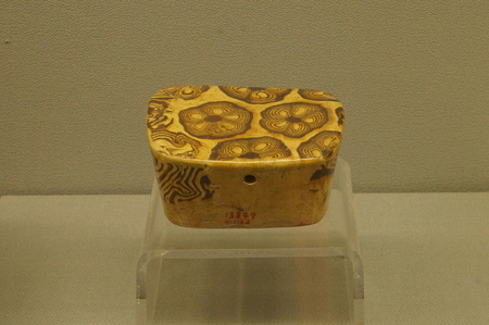 tang: Twistable Glazed Porcelain Pillow, Tang Dynasty 618-907A. D.. Museum of Kaifeng City, Henan Province. Editorial