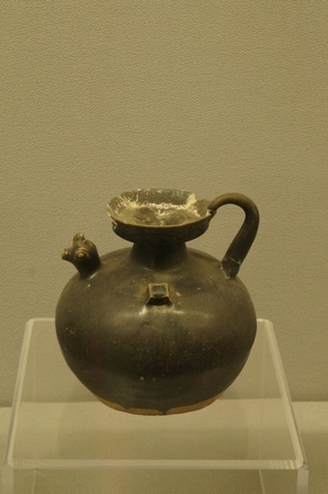 ewer: Black Glazed Chicken-spout Ewer with Dishlike Mouth, Jin Dynasty 265-420A. D. Museum of Kaifeng City, Henan Province. Editorial