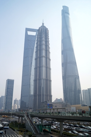 overbridge: Shanghai World Financial CenterSWFC, Jin Mao Tower, Shanghai Tower and other high-rise buildings, in Lujiazui Finance and Trade Zone, Pudong New District, Shanghai City, 26, February, 2016. Editorial