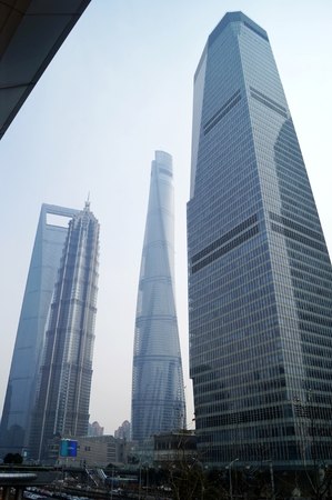jin mao tower: Shanghai World Financial CenterSWFC, Jin Mao Tower, Shanghai Tower and other high-rise buildings, in Lujiazui Finance and Trade Zone, Pudong New District, Shanghai City, 26, February, 2016. These buildings are considered as the skyline or iconic buildings