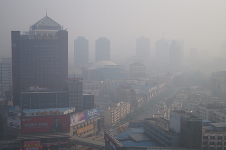 View of high-rise buildings and cars on the street in heavy smog in Zhengzhou city, central Chinas Henan province. Editorial