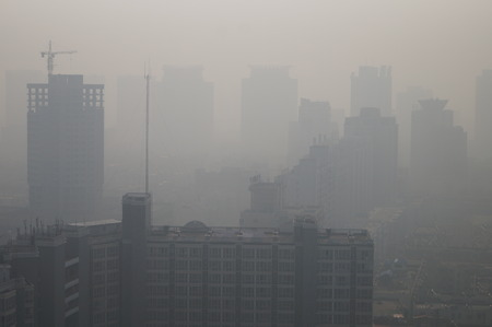 View of high-rise buildings in heavy smog in Zhengzhou city, central Chinas Henan province Editorial