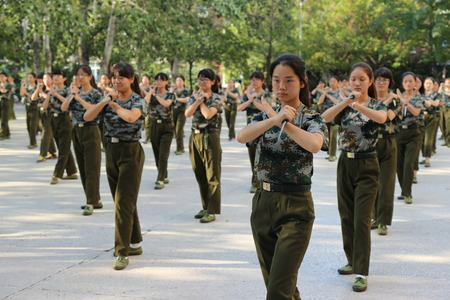129 female Chinese students holding daggers take part in a military training at Zhengzhou University in Zhengzhou city, central Chinas Henan province, 8 September 2016. Freshmen will take compulsory military training in Chinas colleges.