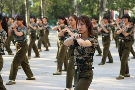 freshmen: 129 female Chinese students holding daggers take part in a military training at Zhengzhou University in Zhengzhou city, central Chinas Henan province, 8 September 2016. Freshmen will take compulsory military training in Chinas colleges.