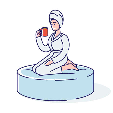 Relaxed woman in towel and bathrobe drinks tea after bath, relaxing massage or sauna in spa salon