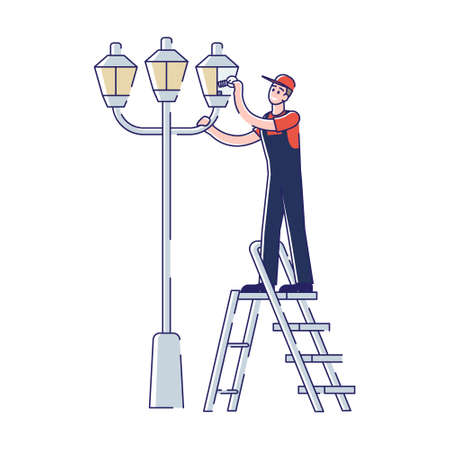 Electrician changing light bulbs in street light. Lineman repair streetlight change lamp