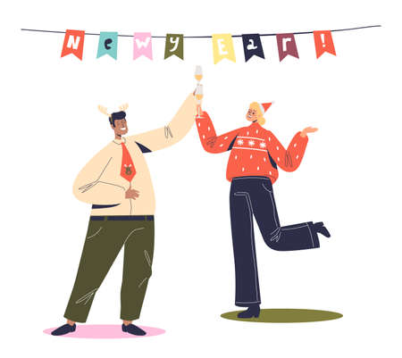 Cheerful man and woman dancing on corporate new year party. Happy coworkers celebrate christmas