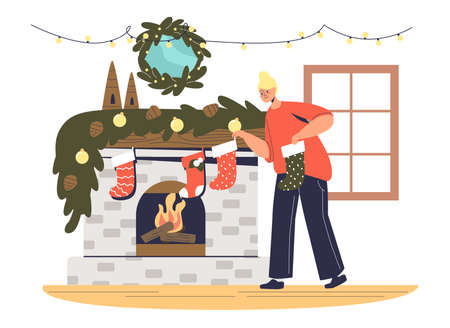 Mother hanging christmas socks on fireplace for presents and gifts preparing for winter holidays
