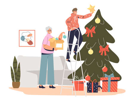 Happy grandmother decorating christmas tree together with grandson hanging star to pine top
