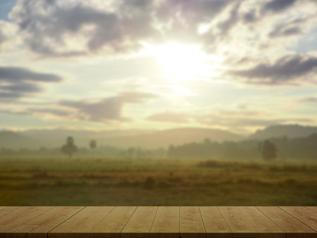 Vintage Wooden floor with Blur landscape view Rice field and Mountain in morning. Imagens