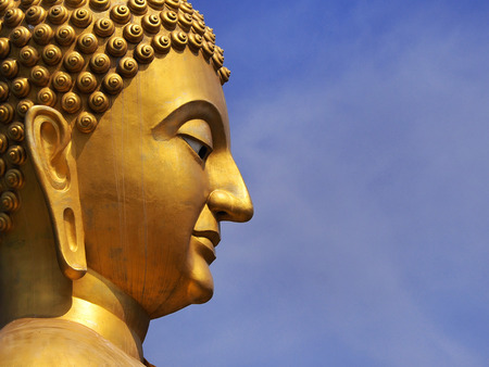 Close up the face of Bhuddha Sculpture in Makha Bucha Memorial Park in Nakhon Nayok, Thailand 2016