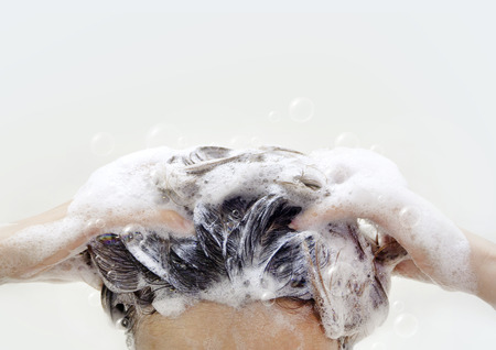 Women washing hair with more Shampoo bubbles