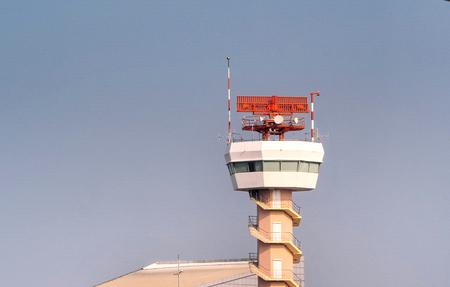 An airport surveillance radar with blue sky background