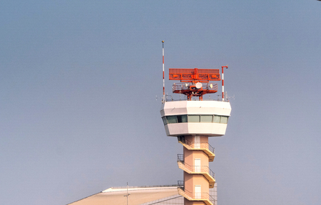 An airport surveillance radar with blue sky background