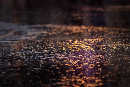 Water reflection on the road with light Фото со стока