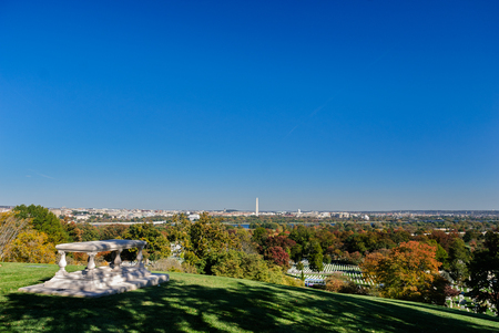Overlooks view of Washington DC from Memorial table outside of Robert Lee House at Arlington Cemetery in autumn Stock Photo