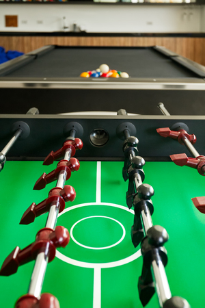Closeup of soccer table with pool table Stock Photo