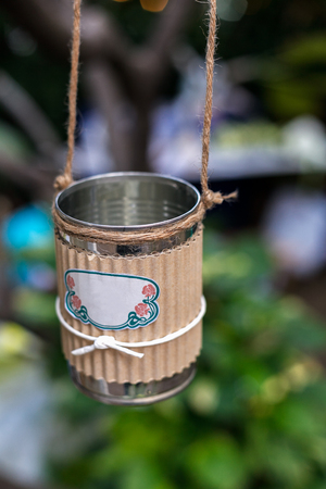Wedding decoration in the form of hanging milk can with manila rope