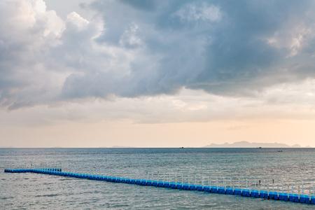 blue rotomolding or plastic jetty under big cloudy sky in rainy season , ko Samui , Thailand