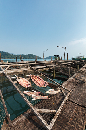 A scene of making Thai dried salted fish style at fish farming at ko Chang , Thailand