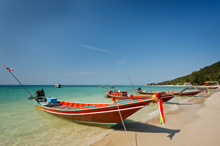 Thai local long tale boats at the beach under clear blue sky at Koh Tao , Thailand Stock Photo