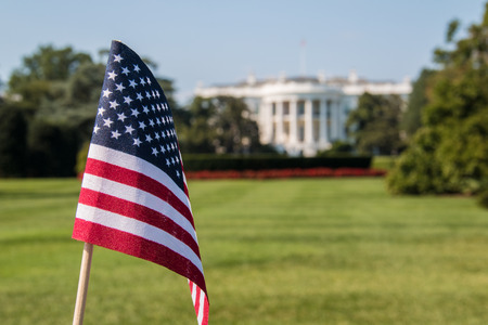 American flag in front at White House During a sunny day in Washington DC
