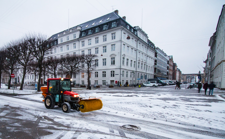 machinery: COPENAGHEN - JAN 07, 2017: Snowplow in action near Nyhavn during a snowy day.