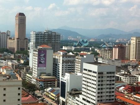 kuala lumpur city: Kuala Lumpur highrise buildings with mountain in the backgroud