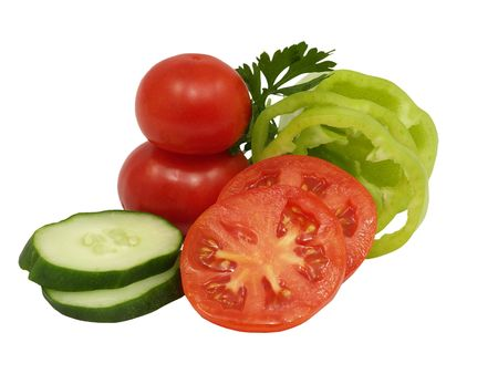 Fresh sliced cucumber, green pepper and tomato on a white background. Stock Photo