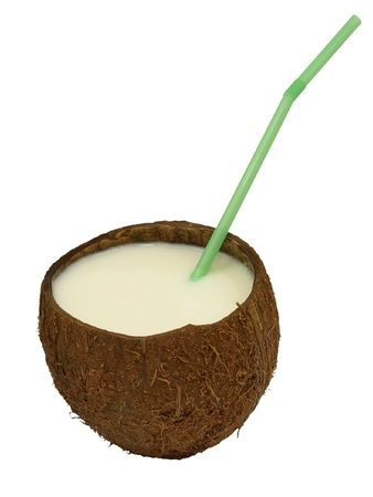 Coconut with a milk- shake and green cocktail straw.